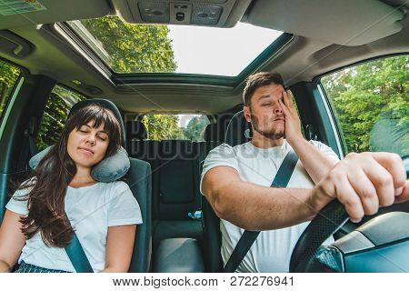 Couple In Car. Tired Driver. Road Trip. Summer Time