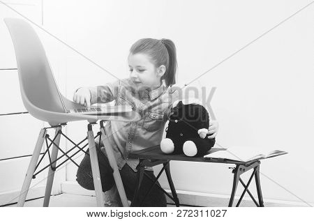Technology. Playing And Learning, Happy, Pretty, Small, Little Girl, Child, Smiling To Pretty, Teddy