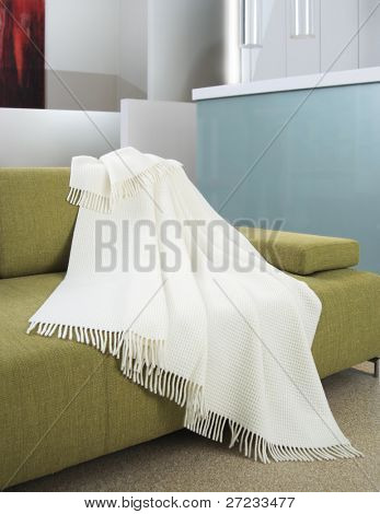 White blanket draped over a settee