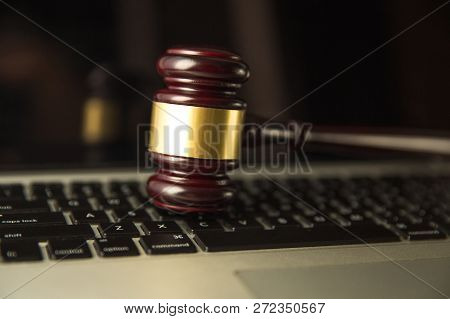 Online Auction. Auction Or Judge Gavel On A Computer Keyboard. 3d Illustration.yber Law Or Online Au