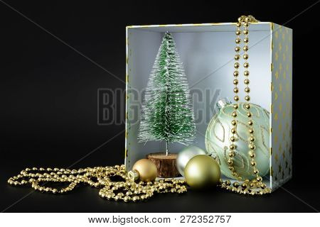 A Christmas decoration gift box on black background