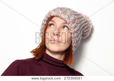 Isolated Portrait Of Beautiful Young Redhead Girl With Green Eyes Purple Sweater Pink Knitted Hat Wi