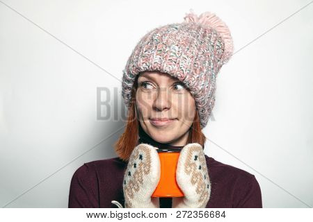Isolated Beautiful Young Redhead Girl With Green Eyes Purple Sweater Pink Knitted Hat With Pompon Dr