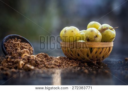 Close Up Of Raw Amla Or Phyllanthus Emblica Or Indian Gooseberry In A Fruit Basket With Its Dried Se