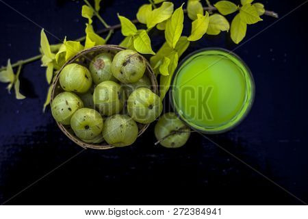Close Up Of Extracted Beneficial Juice Of Amla Or Indian Gooseberry Or Phyllanthus Emblica In A Tran