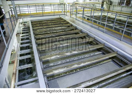Inside modern wastewater treatment plant. Flotation tank with waste water. poster