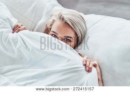Too Lazy To Wake Up. Top View Of Attractive Young Woman Covering Half Of Her Face With Blanket And L