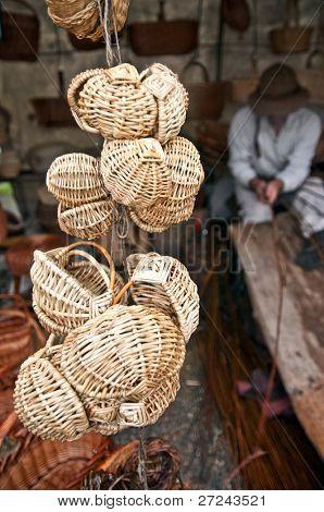 artisans weave baskets