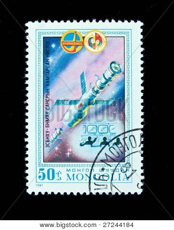 MONGOLIA- CIRCA 1981: A stamp printed in Mongolia shows spacestation Salut, stamp from series honoring Intercocmos program, circa 1981.