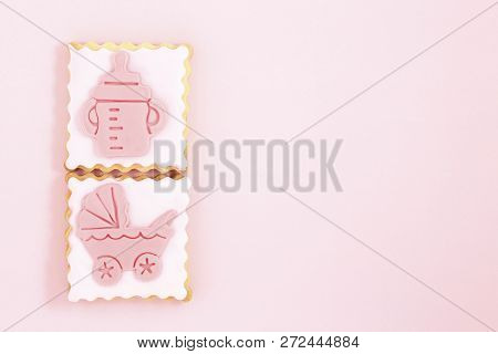 Pastries With Stroller And Feeding Bottle On Pink With Copy Space