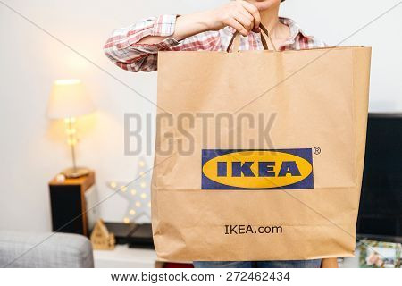 Paris, France - Dec 2, 2018: Qwoman With Big Paper Ikea Bag Full With Merchandise From The Famous Sw