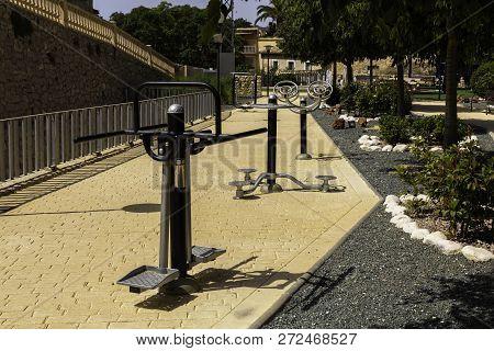 Sidewalk Outdoor Exercise Equipment. Outdoor Fitness Equipment Workout. Public Exercise Equipment