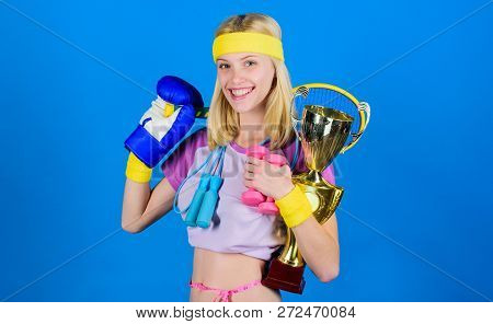 Champion Concept. Girl Successful Modern Woman Hold Golden Goblet Of Champion. Woman Good In Tennis