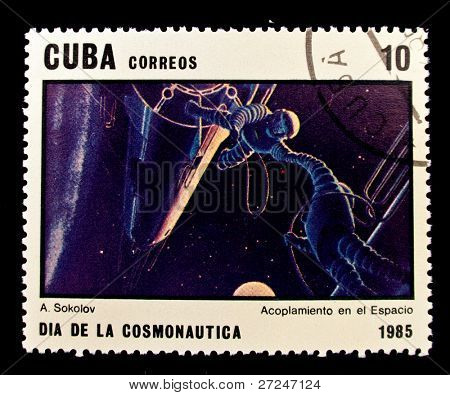 CUBA - CIRCA 1985: A stamp printed in the Cuba shows cosmonauts in open space, circa 1985. Big space series