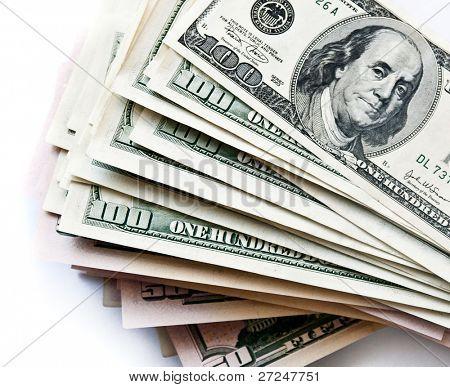 few 100 dollar bills on white background