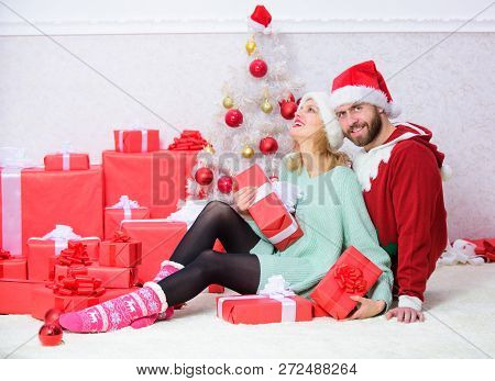 Christmas Is Time For Giving. Couple In Love Enjoy Christmas Holiday Celebration. Family Prepared Ch