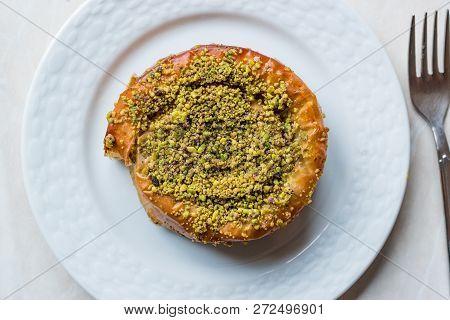 Turkish Konya Dessert Sac Arasi with Pistachio Powder / Kunefe Kadayif or Katmer. Traditional Dessert. poster