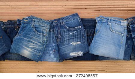 Stacked of Jeans.on wooden background