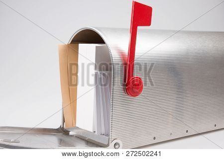 Mail Box Overflowing With Mail Bills Junk Mail E-mails And Other Unwanted Correspondence