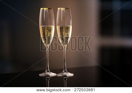 A Pair Of Glasses Of Champagne In The Interior. Festive Picture Of Two Wine Glasses With Sparkling C