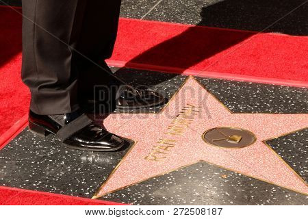 LOS ANGELES - DEC 4:  Ryan Murphy shoes on his WOF Star at the Ryan Murphy Star Ceremony on the Hollywood Walk of Fame on December 4, 2018 in Los Angeles, CA
