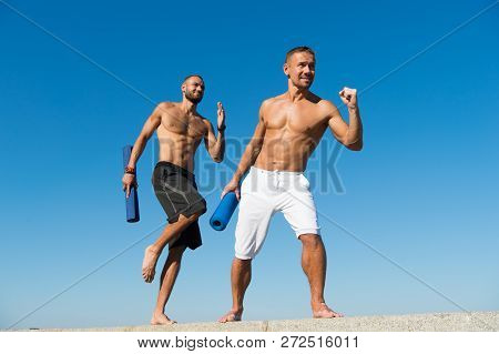 Towards Health. Men Hurry Up Outdoor Yoga Practice. Muscular Men Training On Fresh Air. Developing M