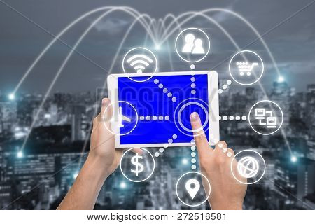 Hand Holding Digital Tablet With Smart Technology Icon And Tokyo City With Network Connection Concep