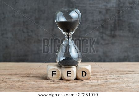 Federal Reserve, Fed Target And Speed To Raise Interest Rate Concept, Hourglass Or Sandglass On Cube