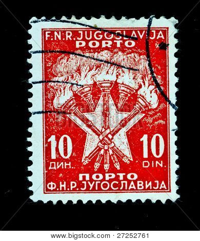 YUGOSLAVIA - CIRCA 1950: A stamp printed in Yugoslavia shows image of torches, series, circa 1950