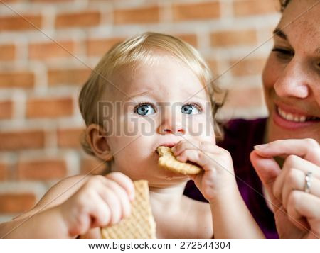 Baby munching on some crackers