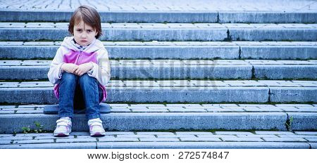 Portrait Of Little Cute Child Girl Expressing Sadness And Loneliness. Gestures, Body Language, Facia