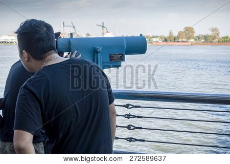 New Orleans, Usa - Dec 4, 2017: Two Men Enjoying The View Across The Iconic Mississippi River With A