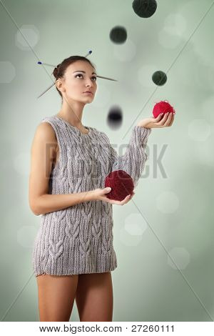 woman juggle clew with one sleeve sweater