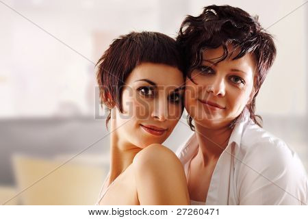 women couple happy attractive at home