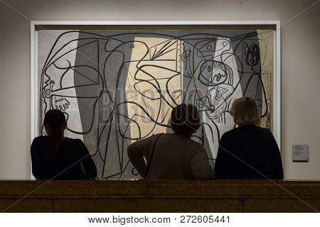 Moscow, Russia - November 21, 2018: People near the Pablo Picasso painting -Picasso Painter and his Model- in Pushkin Museum of Fine Arts is largest museum of European art in Moscow.