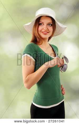 summer woman young cheerful in panama and  sunglasses enjoying over green nature background