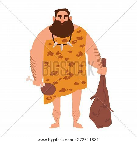 Primitive Archaic Man Dressed In Clothes Made Of Animal Skin And Holding Cudgel. Caveman From Stone