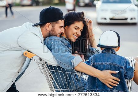 Dad Carries Mom In A Trolley With A Supermarket