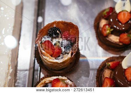 Fruit And Berry Tartlets Dessert On Tray Assorted Top View Background