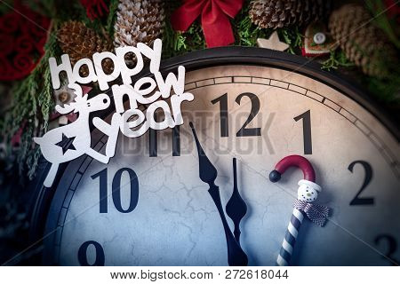 Wall Clock In Christmas And New Year Decorations Are Wrapped With Fir Branches And Christmas Decorat
