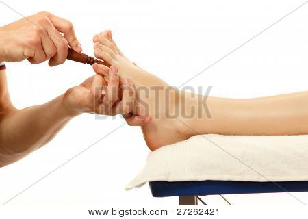 masseur makes foot massage young woman isolated on white background poster