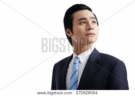 Portrait Of Pensive Ambitious Asian Entrepreneur Looking Up, Isolated On White