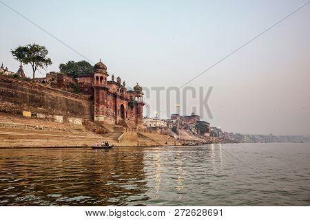 Varanasi, Uttar Pradesh, India. A View From River Ganges Of Old Historical Varanasi City With Weathe