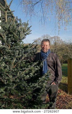 Man with his real Christmas Tree