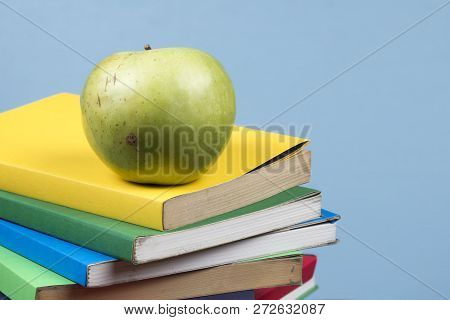 Apple Fruit On Top Of A Book Stack, On The Back Of School Classes