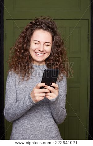 Closeup Portrait Smiling Or Laughing Young Freelancer Woman Looking At Phone Seeing Good News Or Pho