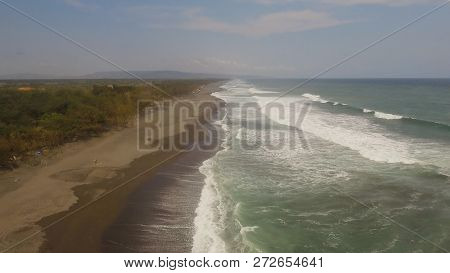 Aerial View Sandy Beach Near Ocean With Big Waves At Sunset Time In Tropical Resort, Yogyakarta, Ind
