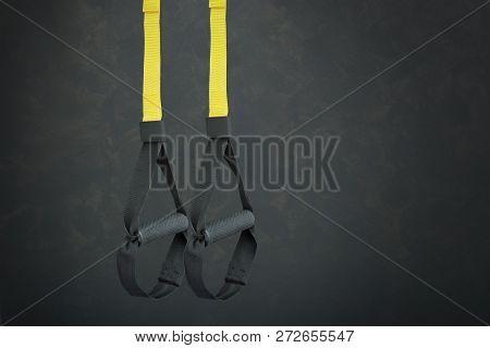 Straps Training Loop Equipment. Black Loop Functional Training Equipment On Grey Background. Sport A