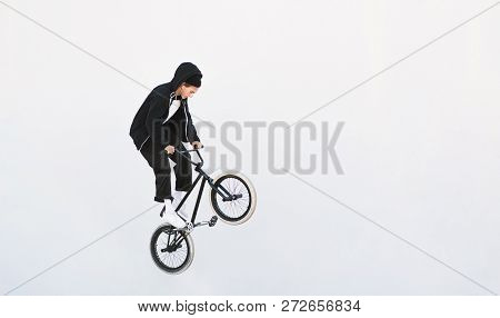Bmx Freestyle. Young Bmx Bicycle Makes Tricks On The White Background. Copyspace7 Bmx Trick On A Whi