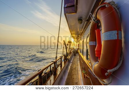 Sunset at the Sailboat deck while cruising in the Cyclades in Greece